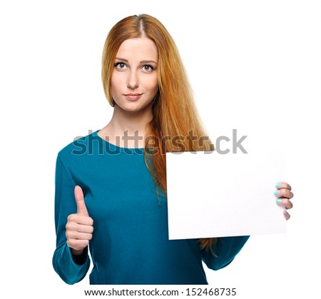 Attractive young woman in a blue shirt. Holds a poster and showing thumbs up. Isolated on white background