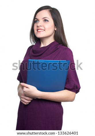 Attractive young woman in a dress. Woman holds a blue folder and looks right. On a white background