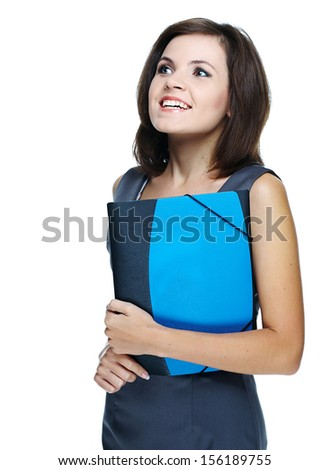 Attractive young woman in a gray business dress. Holds a folder. Isolated on white background