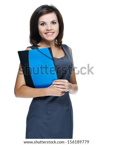 Attractive young woman in a gray business dress. Holds a folder. Isolated on white background - stock photo