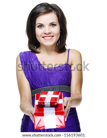 Attractive young woman in a lilac dress. Holds the gift box. Isolated on white background