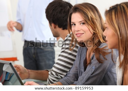 Attractive young woman in a meeting - stock photo