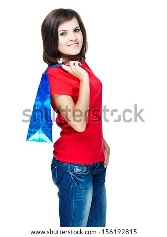 Attractive young woman in a red shirt. Holds the gift bag. Isolated on white background