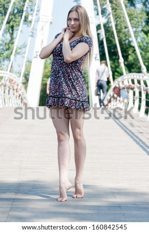 Attractive young woman in city. Portrait of a beautiful young girl outdoors