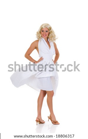 Attractive young woman in classy white dress.  Marilyn Monroe imitation. Studio shot, white background. - stock photo