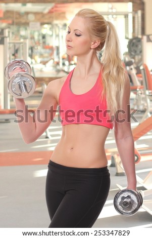 attractive young woman  in fitness sport club - stock photo