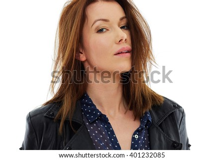 Attractive young woman in leather jacket, portrait over white background, isolated - stock photo