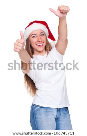 attractive young woman in santa hat showing thumbs up. studio shot over white background