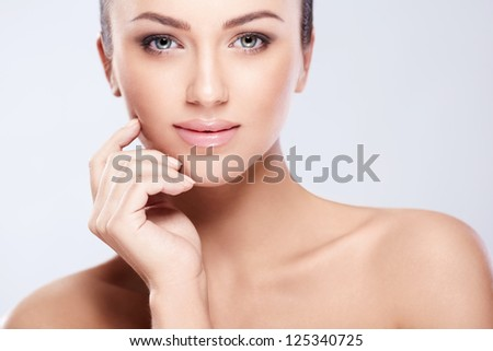 Attractive young woman in studio - stock photo
