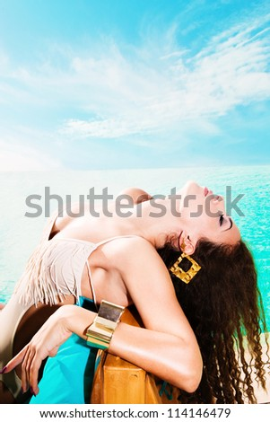 attractive young woman in swimwear by the pool - stock photo
