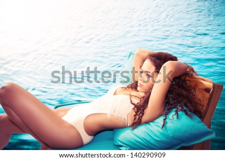 attractive young woman in swimwear enjoy by the pool summer day shot, retro colors