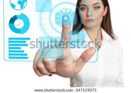 Attractive young woman in white blouse using touch screen - stock photo