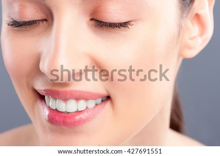 Attractive young woman is expressing positive emotions - stock photo