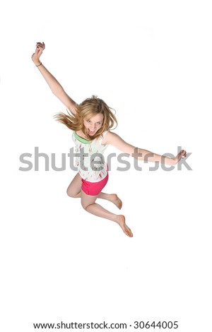 attractive young woman jumping for joy as seen from above - stock photo