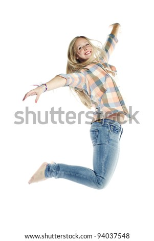 Attractive young woman jumping in the air against white background - stock photo