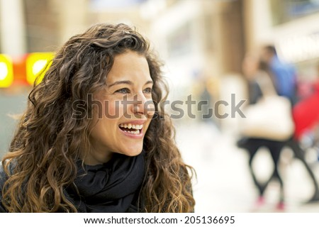 Attractive young woman laughing at something. Concept of happiness - stock photo