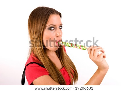 Attractive young woman licking colorful lollipop. - stock photo