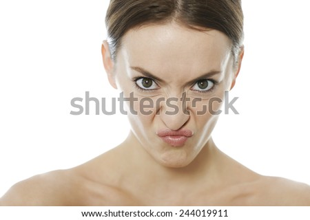 Attractive young woman looking disgusted and annoyed - stock photo