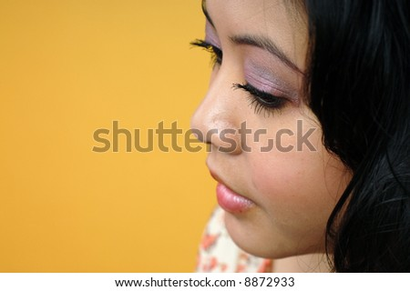 Attractive young woman looking down in a doubtful moment