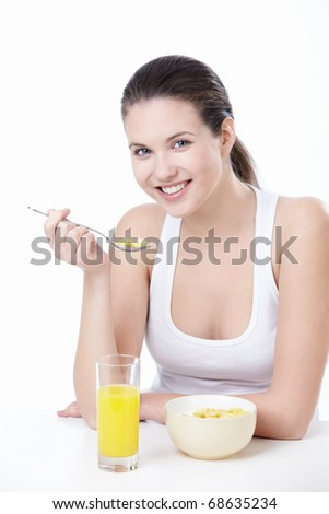 Attractive young woman lunching on white background - stock photo
