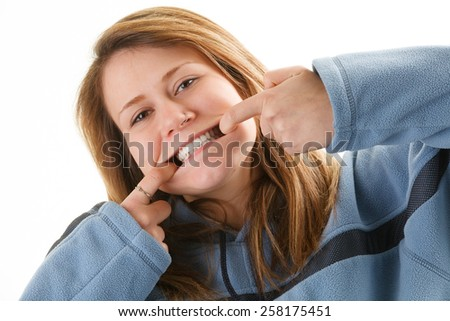 Attractive young woman making funny faces - stock photo