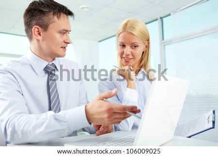 Attractive young woman meeting with an experienced businessman for a training - stock photo