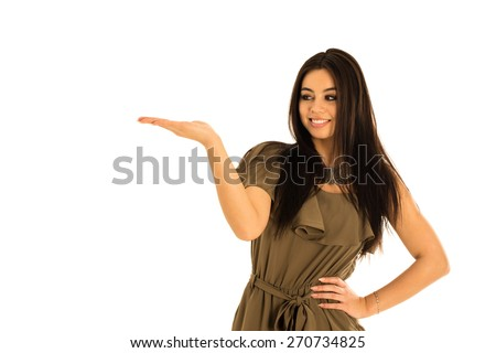 Attractive young woman, multi-racial Asian and Caucasian, looking at your product with great joy. Isolated on white background, your prodcut can be placed on the palm of her hand.  - stock photo