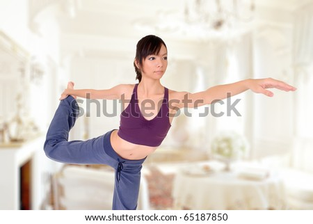 Attractive young woman of Asian doing expert yoga excising in home. - stock photo