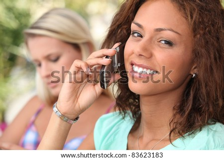 Attractive young woman on a cellphone - stock photo