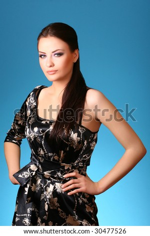 attractive young woman on blue - stock photo