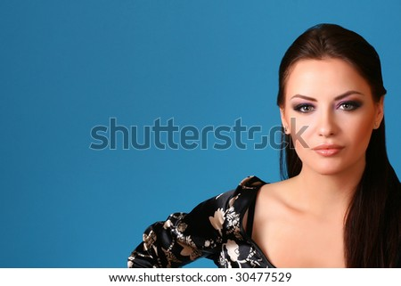 attractive young woman on blue background - stock photo