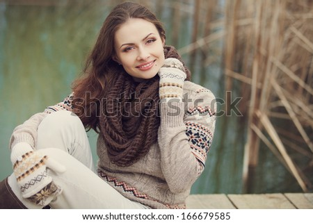 Attractive young woman on the lake