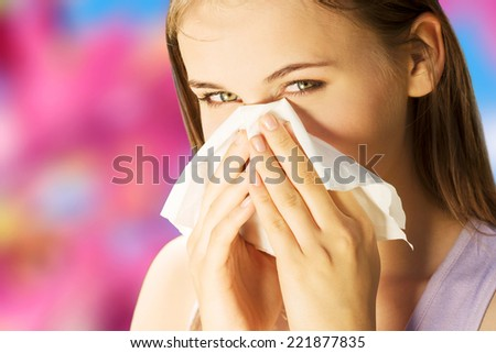 Attractive young woman outdoor with white tissue. - stock photo