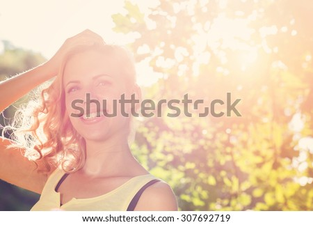 Attractive young woman outside in summer nature
