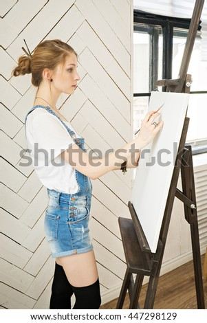 attractive young woman . painting theme - stock photo