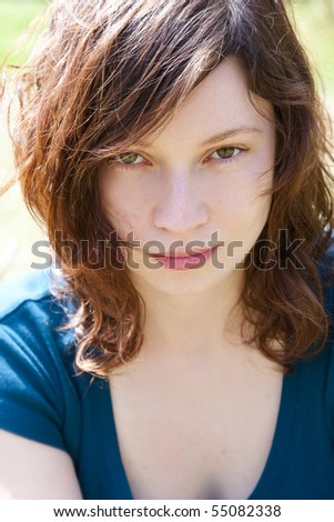 Attractive young woman portrait under the sunlight - stock photo