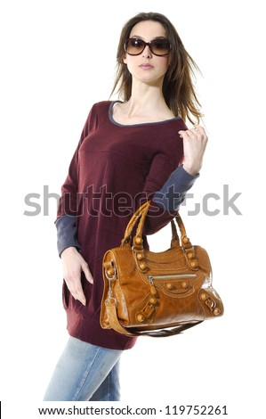 Attractive young woman posing girl in sunglasses with bag - stock photo