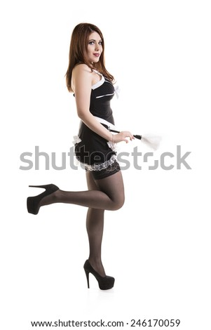 Attractive Young Woman Posing In A Skimpy Maids Uniform Over White Background - stock photo