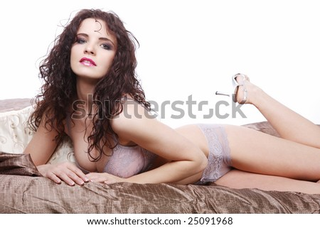 Attractive young woman posing in lingerie. - stock photo