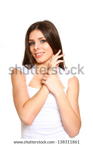 Attractive young woman posing on  white background close-up