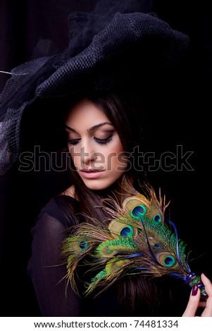 Attractive young woman posing, retro style, studio shot - stock photo