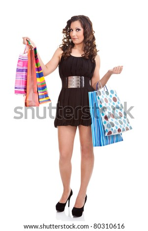 attractive young woman posing with shopping bags, isolated on white background - stock photo