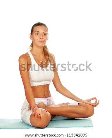 Attractive young woman practicing yoga - stock photo