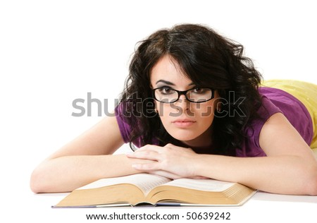 Attractive young woman reading book - stock photo