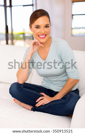 attractive young woman relaxing at home