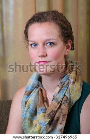 Attractive young woman relaxing in beautiful clothes and scarf - stock photo
