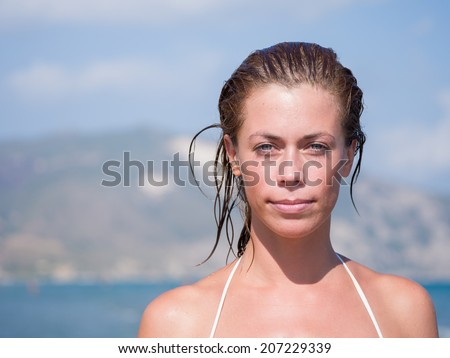 Attractive young woman relaxing on the beach - stock photo