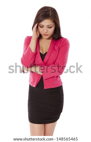 Attractive young woman rubs her head in pain, isolated on a white background.
