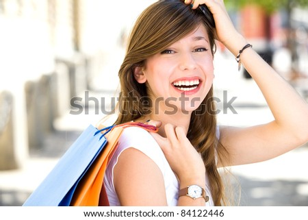 Attractive young woman shopping - stock photo