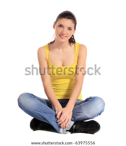 Attractive young woman siitng on the floor. All on white background. - stock photo